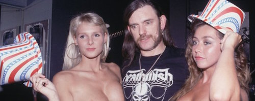 Lemmy from Motorhead With Two Page Three Girls, During A Press Conference in Guildford, England 20/03/1991. (Photo by Mark Baker/Sony Music Archive/Getty Images)